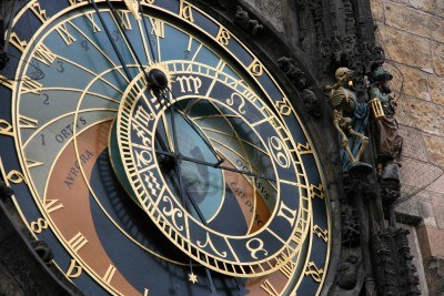 4014182-famous-astronomical-clock-in-prague-czech-republic-skeleton-statue-next-to-it-symbolizing-time-passi